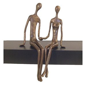 Home. sitting bronze couple